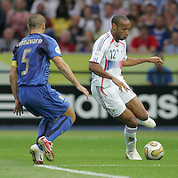 Fabio Cannavaro, Thierry Henry.  Italy defeated France on penalty kicks after leaving the score tied, 1-1, in regulation time in the FIFA World Cup final match at Olympic Stadium in Berlin, Germany, July 9, 2006.