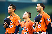 Houston Astros teammates Carlos Pena (12), Jose Altuve (27) and Marwin Gonzalez (9) pause during the national anthem before the MLB baseball game against the Detroit Tigers on May 3, 2013 at Minute Maid Park in Houston, Texas. Detroit defeated Houston 4-3. (Andrew Woolley/Four Seam Images).