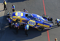 Aug 15, 2014; Brainerd, MN, USA; Crew members surround NHRA funny car driver Ron Capps during qualifying for the Lucas Oil Nationals at Brainerd International Raceway. Mandatory Credit: Mark J. Rebilas-