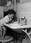 Wilkinsburg PA:  Helen Stewart brushing her teeth before bed.