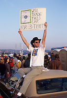 A fan of the Grateful Dead looking for tickets for a concert in Oakland.  Deadheads from around the country gather  for an annual pilgrimage to attend a series of concerts over New Years.   Many camped out for days in the parking lot of the Oakland Coliseum,  where merchandise of all kinds is peddled day and night.