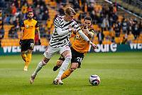 23rd May 2021; Molineux Stadium, Wolverhampton, West Midlands, England; English Premier League Football, Wolverhampton Wanderers versus Manchester United; Brandon Williams of Manchester United competes with João Moutinho of Wolverhampton Wanderers for the ball