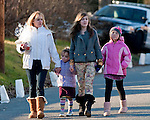 WOODBURY, CT 19 DECEMBER- 121912JS04- A group of women bring a tray of cookies to the police outside Mourners  Munson-Lovetere Funeral Home in Woodbury on Wednesday during calling hours for Sandy Hook Principal Dawn Hochsprung Jim Shannon Republican American