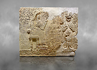 "Hittite relief sculpted orthostat stone panel  of Long Wall Limestone, Karkamıs, (Kargamıs), Carchemish (Karkemish), 900-700 BC. Anatolian Civilisations Museum.<br /> <br />  The hieroglyphics reads; ""I am Win-a-tis, beloved wife of my Lord Suhi, wherever and whenever my husband honours his name, he will honour my name as well with favours"". Underneath, there are two goddess figures, one is naked with a horned head, holding her breasts with her hands. Her genitalia is indicated by a triangle. <br /> <br /> On a grey art background."
