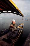 A Kashmiri muslim prays on his shikara at Dal Lake. Srinagar, Jammu and Kashmir, India, Arindam Mukherjee