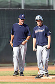 Baseball Factory coach Rick Sofield talks to a runner on third during the Arizona Fall Classic at Peoria Sports Complex on October 29, 2011 in Peoria, Arizona.  (Copyright MIke Janes Photography)