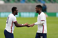 BELFAST, NORTHERN IRELAND - MARCH 28: Daryl Dike #19 of the United States and Jordan Siebatcheu #16 of the United States during a game between Northern Ireland and USMNT at Windsor Park on March 28, 2021 in Belfast, Northern Ireland.