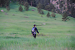 Woman hiking while using smart phone, Foothills, Boulder, Colorado