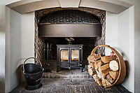 BNPS.co.uk (01202 558833)<br /> Pic: Hamptons/BNPS<br /> <br /> Pictured: A wood-burning stove.<br /> <br /> An incredible Arts and Crafts country house with its own vineyard is on the market for offers over £7m.<br /> <br /> The Grade II listed St Joseph's Hall is a striking 111-year-old property that was home to the Bishop of Arundel for 40 years.<br /> <br /> It has a wealth of period features, an indoor swimming pool and seven acres of vineyard with mostly Chardonnay grapes, which the owners sell to a local winery.<br /> <br /> The house in Storrington, West Sussex, has 17 acres of land with beautiful views over the South Downs.
