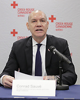 Conference de presse de la croix rouge. le 8 j anvier 2015.<br /> Conrad Sauvé (D)<br /> <br /> PHOTO : Agence Quebec Presse
