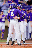 Mikie Mahtook #8 of the LSU Tigers is greeted at home plate by teammate Tyler Hanover #11 after hitting a home run against the Wake Forest Demon Deacons at Alex Box Stadium on February 20, 2011 in Baton Rouge, Louisiana.  The Tigers defeated the Demon Deacons 9-1.  Photo by Brian Westerholt / Four Seam Images