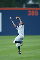 Justin Turner of the Cal State Fullerton Titans attempts to catch a fly ball during a game at Goodwin Field on June 6, 2003 in Fullerton, California. (Larry Goren/Four Seam Images)