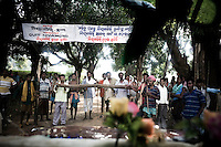 Protest at the makeshift gate that has been set up by the local Kondh villagers to stop Vedanta officials from accessing the proposed mining area. The huge bauxite deposits in the Niyamgiri hills have led the Vedanta group to set up an alumina refinery at Lanjigarh, making the local population of Dongria Kondh tribespeople fearful for their future. Vedanta Resources has come under immense pressure from human rights and environmental groups to abandon its plans to mine at the Niyamgiri mountains, as the site is considered sacred by the local tribal community....