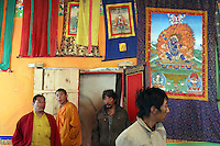 Visitors to a buddhist temple in the town of Zaduo on the Tibetan Plateau, in western China.