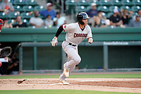 First baseman Dustin Harris (9) of the Hickory Crawdads in a game against the Greenville Drive on Tuesday, August 24, 2021, at Fluor Field at the West End in Greenville, South Carolina. (Tom Priddy/Four Seam Images)
