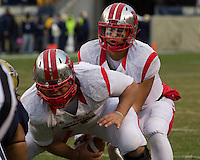 Rutgers center Betim Bujari hikes the ball to quarterback Gary Nova. The Pitt Panthers defeat the Rutgers Scarlet Knights 27-6 on Saturday, November 24, 2012 at Heinz Field , Pittsburgh, PA.