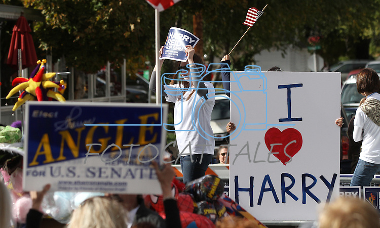 A Sharron Angle supporter waves her sign at the Harry Reid float as it passes during Saturday's Nevada Day parade in Carson City, Nev. .Photo by Cathleen Allison