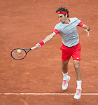 Roger Federer (SUI)  takes the first set in a close match with Dimitry Tursunov (RUS) at  Roland Garros being played at Stade Roland Garros in Paris, France on May 30, 2014