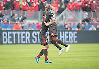 Toronto, Ontario - May 3, 2014: Toronto FC midfielder Jackson Goncalves #11 celebrates his goal with Toronto FC forward Gilberto #9 during a game between the New England Revolution and Toronto FC at BMO Field.<br /> The New England Revolution won 2-1.
