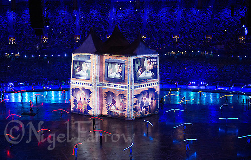 """27 JUL 2012 - LONDON, GBR - Scenes from British TV, films and music videos are projected on a giant house during the """"Frankie and June say...thanks Tim"""" section of the Opening Ceremony of the London 2012 Olympic Games in the Olympic Stadium in the Olympic Park, Stratford, London, Great Britain .(PHOTO (C) 2012 NIGEL FARROW)"""
