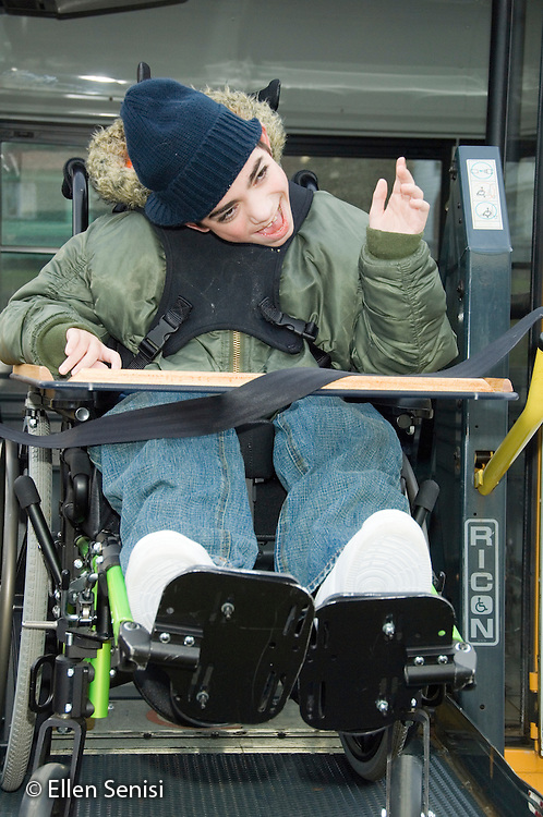 MR / Albany, NY.Langan School at Center for Disability Services .Ungraded private school which serves individuals with multiple disabilities.Child boards schoolbus using Handicapped Lift. Boy: 11, cerebral palsy, expressive and receptive language delays.MR: Bro12.© Ellen B. Senisi