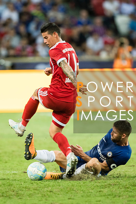 Chelsea Defender Gary Cahill (R) trips up with Bayern Munich Midfielder James Rodríguez (L) during the International Champions Cup match between Chelsea FC and FC Bayern Munich at National Stadium on July 25, 2017 in Singapore. Photo by Weixiang Lim / Power Sport Images
