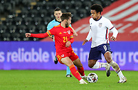 SWANSEA, WALES - NOVEMBER 12: Weston McKennie #8 of the United States  moves past Josh Sheehan #21 of Wales with the ball during a game between Wales and USMNT at Liberty Stadium on November 12, 2020 in Swansea, Wales.