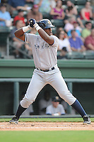Infielder Reymond Nunez (25) of the Charleston RiverDogs, a New York Yankees affiliate, in a game against the Greenville Drive on June 21, 2012, at Fluor Field at the West End in Greenville, South Carolina. Charleston won, 2-1. (Tom Priddy/Four Seam Images)