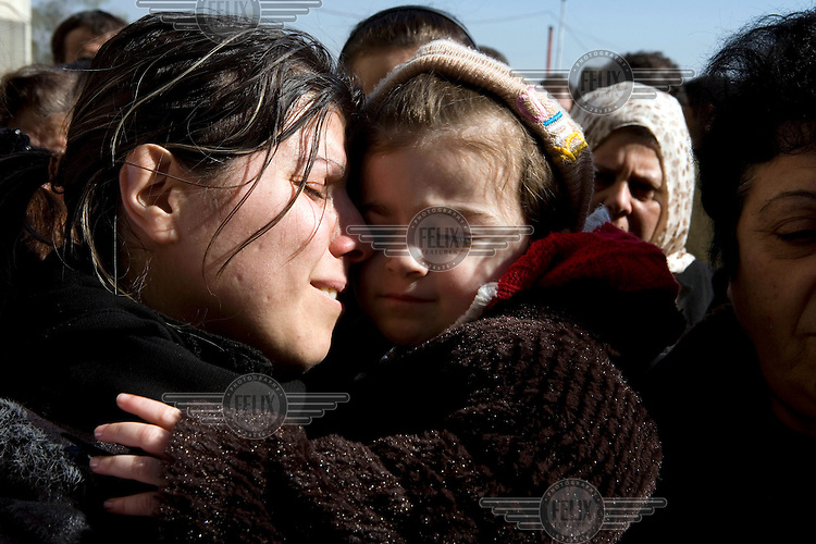 The wife and daughter of Adjutant Marin Saleh Ahmad of the Syrian army surrounded by friends and relatives at his funeral in Damascus. He was shot in the chest by a sniper in the eastern suburbs of the city.Protests against the ruling Baathist regime of Bashar al-Assad erupted in March 2011. Although they were initially peaceful,  they were violently repressed by the Syrian army and police. In response to being ordered to shoot unarmed civilians, large numbers of men deserted the army and formed the Free Syrian Army. The protest movement has now turned into an armed uprising with clashes between the regular army and the Free Syrian Army taking place in early 2012..