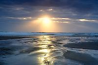 Small stream and sunburst. Rockaway Beach. Oregon