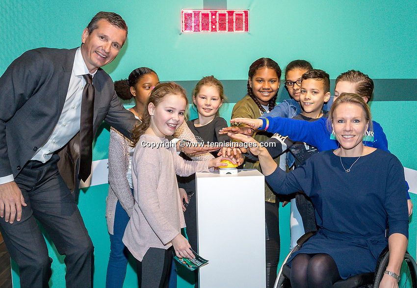 Amsterdam, Netherlands, Januari 10, 2017, Pressconference ABNAMROWTT 2018, Richard Kraijeck  and Esther Vergeer playing with ballkids prior to conference.<br /> Photo: Tennisimages/Henk Koster
