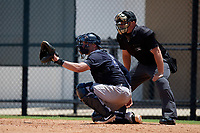 Umpire Chad Patterson and GCL Yankees East catcher Alex Guerrero (8) during a Gulf Coast League game against the GCL Phillies West on August 3, 2019 at the Carpenter Complex in Clearwater, Florida.  The GCL Yankees East defeated the GCL Phillies West 4-0, the second game of a doubleheader.  (Mike Janes/Four Seam Images)