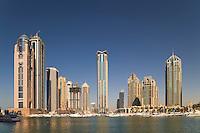 Dubai.  Apartment tower blocks and boats at Dubai Marina..