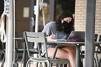 Olivia Weir, a University of Arkansas biology major, studies Sunday Sept. 13, 2020 near the Arkansas Union on the Fayetteville campus. (NWA Democrat-Gazette/J.T.WAMPLER)
