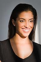 Portrait of young Hispanic woman, smiling