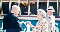 BNPS.co.uk (01202 558833)<br /> Pic: PhilYeomans/BNPS<br /> <br /> Ian Thomas with the Queen.<br /> <br /> A remarkable 'time warp' Royal archive amassed by the Queen's dressmaker has been found inside his old country home.<br /> <br /> The late Ian Thomas was a dress designer for members of the Royal Family, including Her Majesty, for over 30 years.<br /> <br /> As an apprentice he worked alongside the renowned fashion designer Norman Hartnell on creating the Queen's coronation dress in 1953.<br /> <br /> His archive includes embroidered samples of the gown worn by Elizabeth II for the historic ceremony in Westminster Abbey that was broadcast to millions.<br /> <br /> Mr Thomas also designed outfits for the Queen Mother and Princess Margaret.