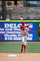 Clearwater Threshers shortstop Arquimedes Gamboa (7) throws to first base during a game against the Jupiter Hammerheads on April 11, 2018 at Spectrum Field in Clearwater, Florida.  Jupiter defeated Clearwater 6-4.  (Mike Janes/Four Seam Images)