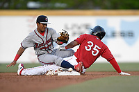 Third baseman Brandon Howlett (35) of the Greenville Drive is safe at second with a double as shortstop Carlos Paraguate (16) the Rome Braves loses the ball in a game on Saturday, April 20, 2019, at Fluor Field at the West End in Greenville, South Carolina. Rome won, 5-4. (Tom Priddy/Four Seam Images)