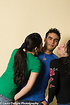 Education High School portrait of male student with two female students, playful, clowning