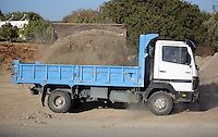 Pictured: A digger loads soil into a tipper lorry at the second site in Kos, Greece. Saturday 15 October 2016<br />Re: Police teams led by South Yorkshire Police are searching for missing toddler Ben Needham on the Greek island of Kos.<br />Ben, from Sheffield, was 21 months old when he disappeared on 24 July 1991 during a family holiday.<br />Digging has begun at a new site after a fresh line of inquiry suggested he could have been crushed by a digger.