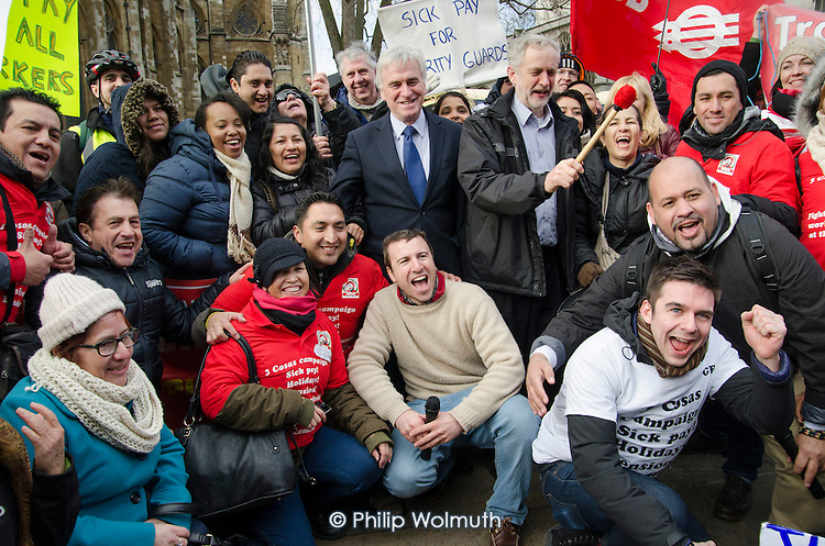 Labout MPs John McDonnell MP and Jeremy Corbyn join a rally outside Parliament during a 3 Cosas Campaign open-top bus tour by outsourced cleaning, security and maintenance workers employed by Cofely GDF-Suez at London University, on strike over union recognition, job losses and conditions of employment.  The mostly Latin-American employees are members of the IWGB union and have already won a pay increase to the London Living Wage. Front row R to L: Alberto Durango, IWGB President, ULU Vice President Daniel Cooper, IWGB Branch Secretary Jason Moyer-Lee, Branch Chair Henry Lopez.
