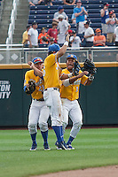 UC Santa Barbara Gauchos outfielders Billy Fredrick (26), Andrew CalicA (21) and Devon Gradford (15) celebrate defeating the Miami Hurricanes in Game 5 of the NCAA College World Series on June 20, 2016 at TD Ameritrade Park in Omaha, Nebraska. UC Santa Barbara beat Miami  5-3. (Andrew Woolley/Four Seam Images)