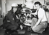 BNPS.co.uk (01202 558833)<br /> Pic: RayFisher/BNPS<br /> <br /> Pictured: RAC patrolman Geoff Crowther and Ray in 1959.<br /> <br /> Tireless Ray Fisher still works full-time in the motorcycle shop he opened 62 years ago - and he has plenty left in the tank.<br /> <br /> The 85 year old founded Ray Fisher's Brickbits in Christchurch, Dorset, in 1959 after training as a bike mechanic.<br /> <br /> It is a family affair as his two children Gerry, 58, and Stephanie, 54, have both worked solely for him since leaving school aged 16.<br /> <br /> Ray said he had loved bikes since childhood and learnt how to repair them while doing national service in the early 1950s.
