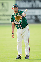 Taylor Krick #17 of the Greensboro Grasshoppers warms up in the outfield at Fieldcrest Cannon Stadium August 2, 2010, in Kannapolis, North Carolina.  Photo by Brian Westerholt / Four Seam Images