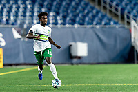 FOXBOROUGH, MA - AUGUST 26: Omar Mohamed #18 of Greenville Triumph SC dribbles at midfield during a game between Greenville Triumph SC and New England Revolution II at Gillette Stadium on August 26, 2020 in Foxborough, Massachusetts.