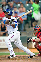 Round Rock Express designated hitter Robinzon Diaz #27 swings during a game against the Memphis Redbirds at the Dell Diamond on July 7, 2011in Round Rock, Texas.  Round Rock defeated Memphis 6-4.  (Andrew Woolley / Four Seam Images)