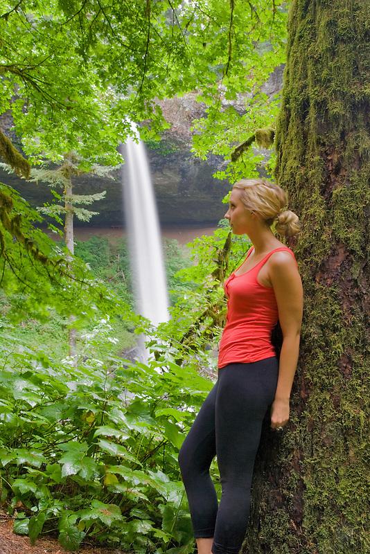Young woman hiking at Silver Falls State Park at North Falls. Oregon