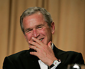 United States President George W. Bush laughs in reaction to Cedric The Entertainer during the annual White House Correspondents' Association dinner at the Washington Hilton in Washington, D.C., Saturday 30 April 2005. The annual dinner began in 1914 as a bridge between the White House and its media corps and tonight feautured a mix of political insiders including Supreme Court Justices, Antonin Scalia and Stephen Breyer, and Hollywood elite such as Goldie Hawn and Richard Gere.<br /> Credit: Katie Falkenberg - Pool via CNP