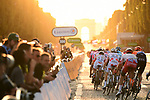 The peloton head up the Champs-Elysees toward the Arc de Triomphe during Stage 21 of the 2019 Tour de France running 128km from Rambouillet to Paris Champs-Elysees, France. 28th July 2019.<br /> Picture: ASO/Pauline Ballet   Cyclefile<br /> All photos usage must carry mandatory copyright credit (© Cyclefile   ASO/Pauline Ballet)