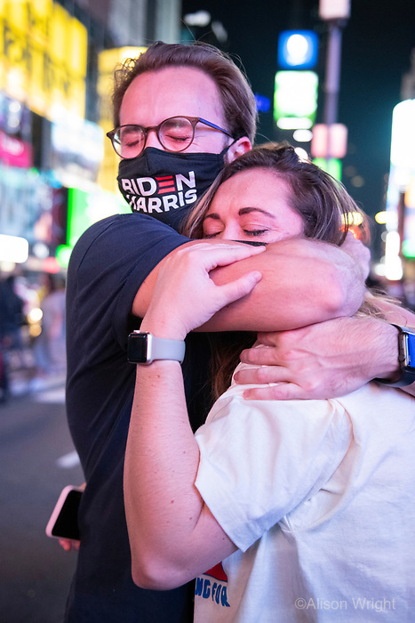 November 7, 2020. Joe Biden and Kamala Harris announce their election win and New York Ciy celebrates. Crowds gather in Times Square to watch the acceptance speech. A couple cries tears of joy.